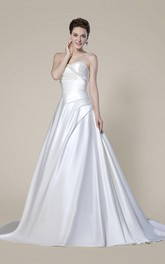 Elegant Strapless Beaded Criss Cross Bridal Gown With Button Back And Draping