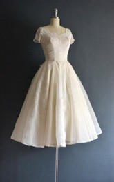Bateau Short Sleeve A-line short Dress With Lace And Pleats