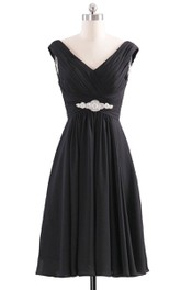 Basque-Waist Crystal Pleated V-Neck Gown